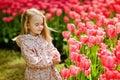 Portrait of a very cute pretty girls blonde in a pink cloak with
