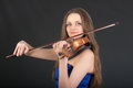 Portrait of violinist on black background closeup Stock Photography