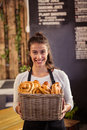 Portrait of waitress holding a basket with viennoiseries Royalty Free Stock Photo