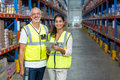 Portrait of warehouse workers standing with digital tablet Royalty Free Stock Photo
