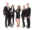 Portrait of welldressed businesspeople full length standing against white background Stock Photo