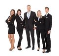 Portrait of welldressed businesspeople full length standing against white background Stock Image
