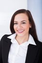 Portrait of welldressed young businesswoman standing in office Royalty Free Stock Photo