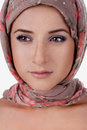 Portrait of white skinned girl in a turban caucasian woman with freckles isolated on background arab hijab posing Royalty Free Stock Photos