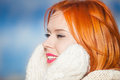 Portrait winter fashion woman warm clothing outdoor beautiful red haired girl in pink lips blue sky background Royalty Free Stock Photos
