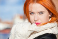 Portrait winter fashion woman warm clothing outdoor beautiful red haired girl in pink lips blue sky background Stock Image