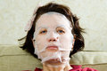 Portrait  woman applying rejuvenating facial mask on her face Royalty Free Stock Photography