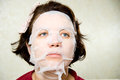 Portrait  woman applying rejuvenating facial mask on her face Royalty Free Stock Photos