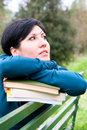 Portrait of a woman beautiful dreaming outdoors with books Royalty Free Stock Image