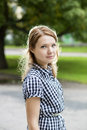 Portrait of woman in blue checkered dress nice Royalty Free Stock Images