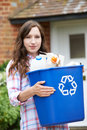 Portrait Of Woman Carrying Recycling Bin Royalty Free Stock Photo