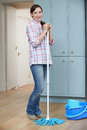 Portrait Of Woman Cleaning Kitchen Floor With Mop Royalty Free Stock Photo