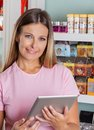 Portrait of woman with digital tablet beautiful mid adult in grocery store Stock Photography