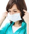 Portrait woman doctor uniform wearing surgical mask Stock Photo