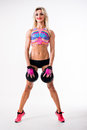 Portrait woman doing workout while holding dumbbell isolated on white background Royalty Free Stock Photo