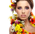 Portrait woman dressed spring flowers Royalty Free Stock Photos