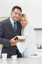 Portrait of a woman embracing well dressed man in kitchen women men the at home Stock Image