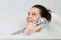 Portrait of a woman enjoying in bathtub bathing and holding shower Royalty Free Stock Images