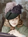 Portrait of a woman with a feathered hat Royalty Free Stock Photos