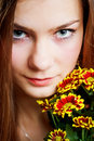 Portrait of woman with flower Stock Photos