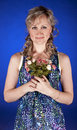 Portrait of woman with flowers Stock Photos