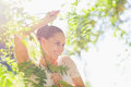 Portrait of woman in foliage looking on copy space Royalty Free Stock Photo