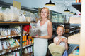 Portrait of  woman and girl gladly shopping groats Royalty Free Stock Photo