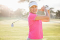 Portrait of woman golfer smiling Royalty Free Stock Photo