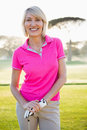 Portrait of woman golfer smiling and posing Royalty Free Stock Photo