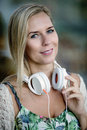 Portrait of a woman with headphones blonde Stock Image