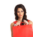 Portrait of a woman holding a red shopping bag Royalty Free Stock Photo
