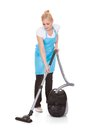 Portrait of woman holding vacuum cleaner Royalty Free Stock Photo