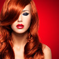 Portrait of a woman with long red hairs beautiful and lips calm face adult pretty girl Royalty Free Stock Image
