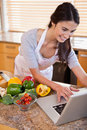 Portrait of a woman looking for a recipe on the internet Stock Photography