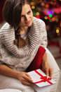 Portrait of woman with postcard in front of christmas lights young Stock Photos