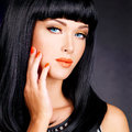 Portrait of a woman with red nails and glamour makeup beautiful long black hairs at studio Royalty Free Stock Photos