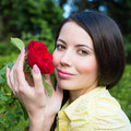 Portrait of a woman with a red rose holding Royalty Free Stock Photo