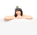 Portrait of a woman in a sailor hat on white young beautiful and sexy girl isolated background Royalty Free Stock Photography