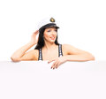 Portrait of a woman in a sailor hat on white young beautiful and sexy girl isolated background Stock Photo