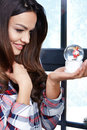 Portrait  woman with a snow globe. Royalty Free Stock Photo