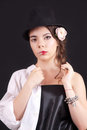 Portrait of the woman with a theatrical makeup on black background Royalty Free Stock Photo