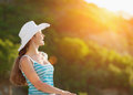 Portrait of woman on vacation enjoying sunset Stock Photos