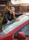 Portrait of woman washing car windscreen outdoor Royalty Free Stock Photography
