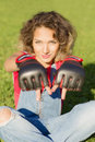 Portrait of a woman is wearing Boxing gloves. Royalty Free Stock Photo