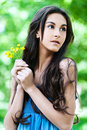 Portrait woman yellow flowers Stock Photos
