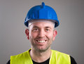 Portrait of a worker expressing positivity isolated on dark background Stock Image
