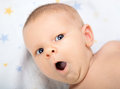 Portrait of a yawning baby Stock Image