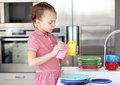 Portrait years old girl washing dishes home Royalty Free Stock Photography