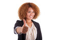 Portrait of a young african american business woman making thumb thumbs up isolated on white background black people Royalty Free Stock Photos