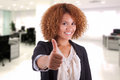 Portrait of a young african american business woman making thumb thumbs up isolated on white background black people Royalty Free Stock Image